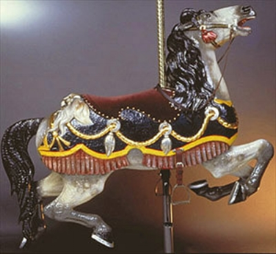 The Red Velvet Saddle Horse Adopted by: Diane Bush Severely damaged in a 1939 fire, this horse shows a pattern of charring on its entire right side. Original paint on the left side provided the colors used in restoration in the 1990s.