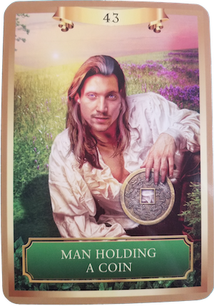 MAN HOLDING A COIN - Energy Oracle Cards