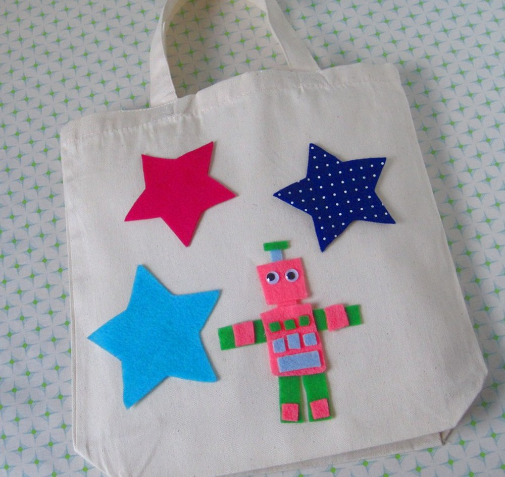 Tote-ally Awesome 1.0, ages 4 and up -  You will design an ivory tote bag using a variety of stencils, fabric markers, and glue-on felt appliques.  We'll provide the tote bag and the fabric, (not to mention trims, google eyes, sparkles, buttons and pom poms!). You provide the inspiration. We guarantee you'll come out with the most unique tote on your Brooklyn block.
