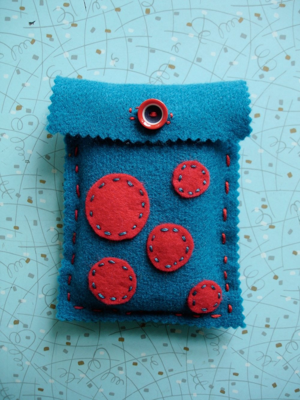 Felt Pouch - ages 8 and up - Design your own one of kind felt pouch! This project is perfect for storing your tech device, jewelry, legos and more! Kids will learn the basics of patterns and hand sewing to sew their pouch, and then finish off their designs with felt appliques, sparkles, pompoms, google eyes, trims and buttons. Your storage options just got a little bit more exciting!