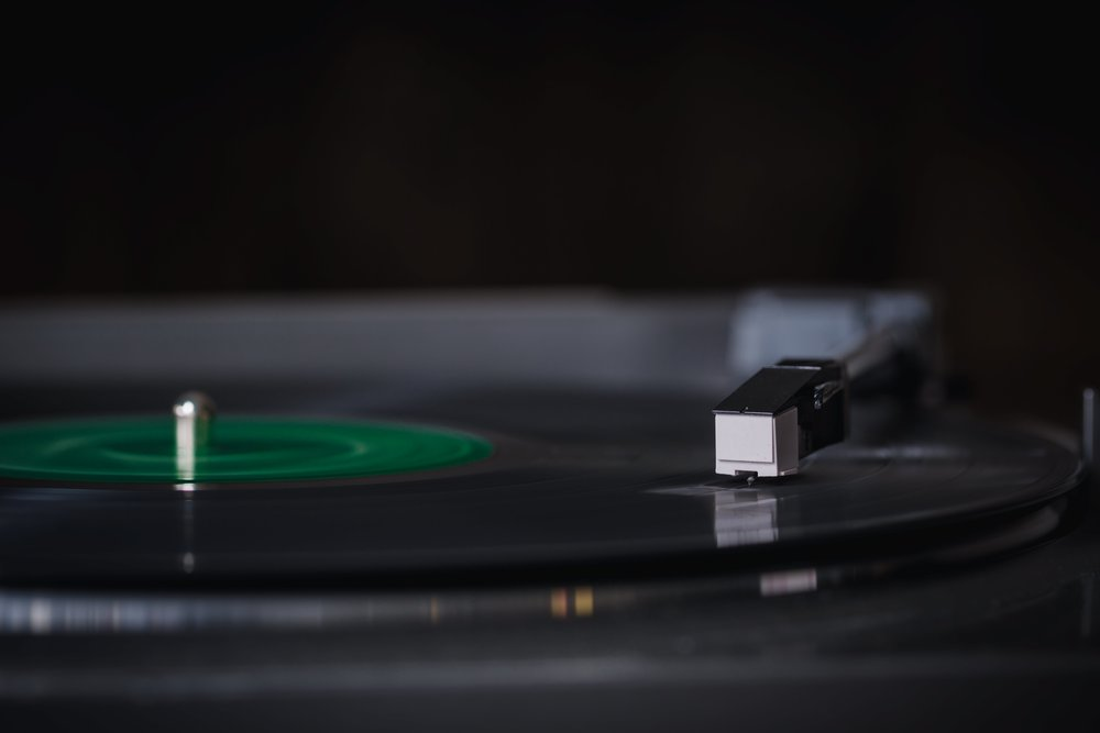 Old vinyl records spins on record player
