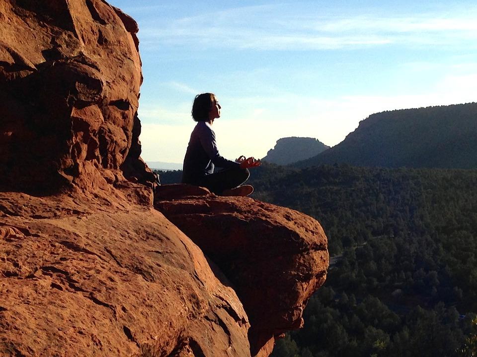 Woman Meditates on Rocky Mountain Outlook
