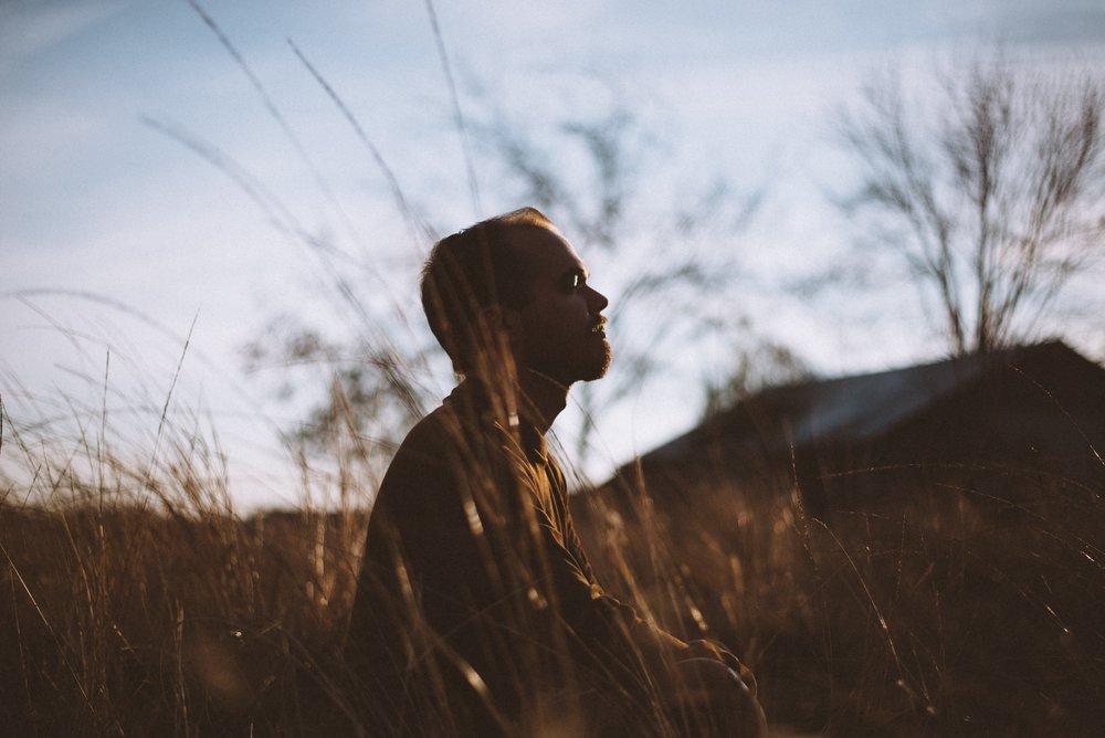 Man Meditates in Open Field