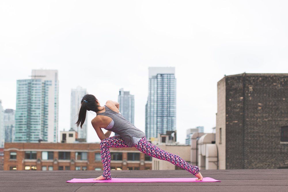 Woman Does Yoga in Front of City Skyline