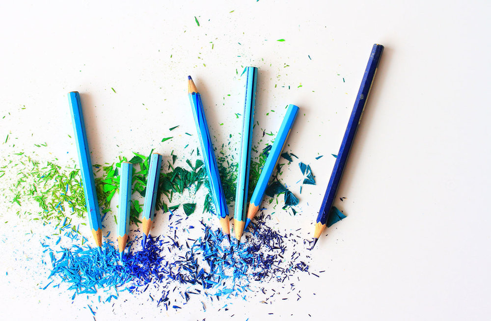 Colored pencils in varying shades of blue