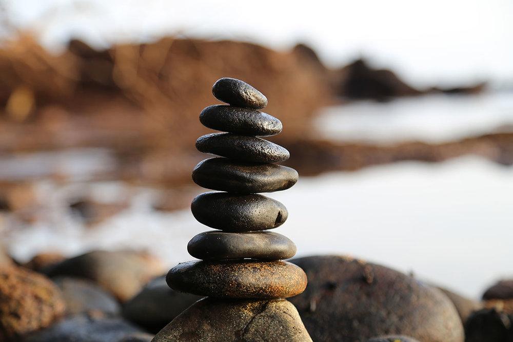 Stacked rocks near a beach
