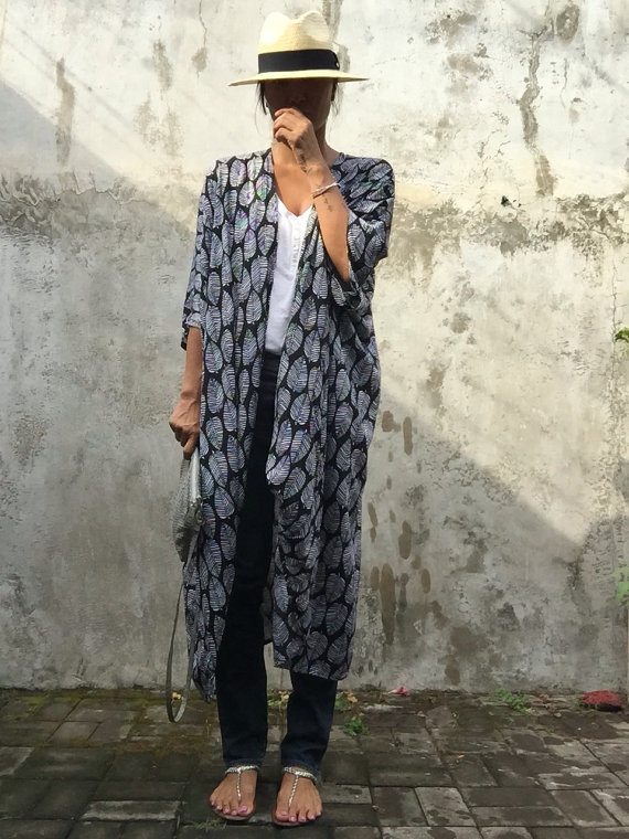 If you have never shopped on Etsy it's time to start. You can find a lot of one-of-a-kind pieces made by hand and to spec. This beautiful kimono is a perfect example. ( Click the picture to be redirected to site)