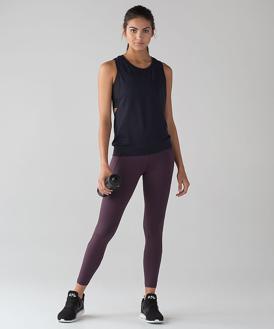 I have this top in every variation. It has a sports bra built in, is open on the sides for air flow and it hugs at the bottom so you won't show skin during inverstions. If you are new to yoga make sure you find one of these!