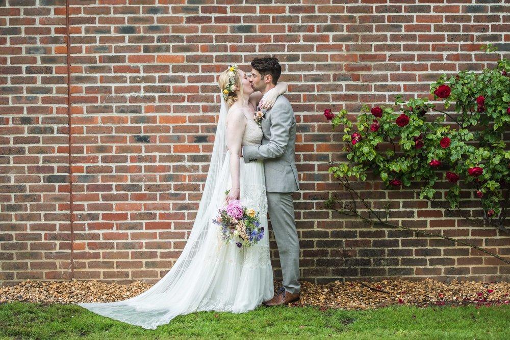 white and blush wedding dress