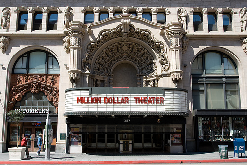 "THE MILLION DOLLAR THEATRE Sid Grauman's first major theatre was named Grauman's Theatre when it opened on February 1, 1918 with William S. Hart in ""The Silent Man."" Following the hype over its price tag it soon became known as Grauman's Million Dollar Theatre, although it was not officially named this until 1922. The auditorium was built behind the twelve story Edison office building; the exterior is a magnificent example of a variation of Spanish Rococo style known as Churrigueresque... READ MORE"