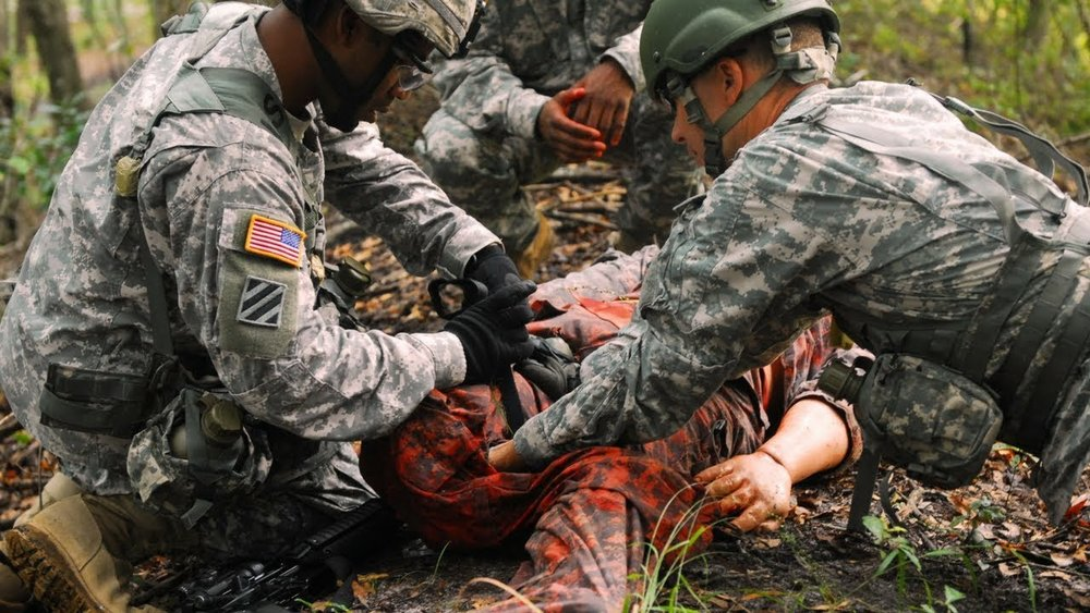 US Army medics train on a simulated patient
