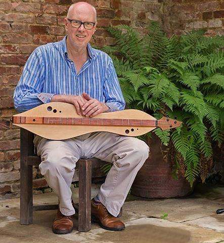 Dan Evans photo w fern.JPG