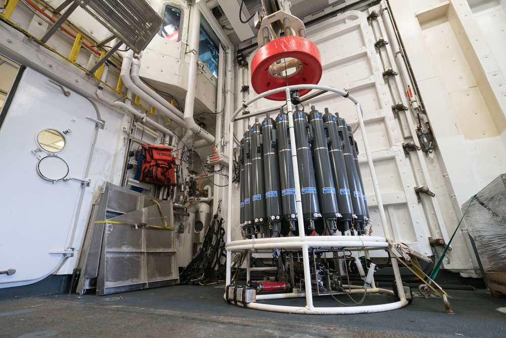 The CTD rosette, loaded with water sampling bottles and optical instrumentation sits ready in the Baltic Room. Photo credit: Andrew McDonnell