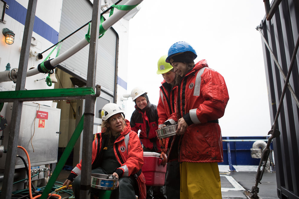 Sarah Hardy and her sediment team filtering out the first multi-core sample of the Arctic Program. Photo credit: Brendan Smith