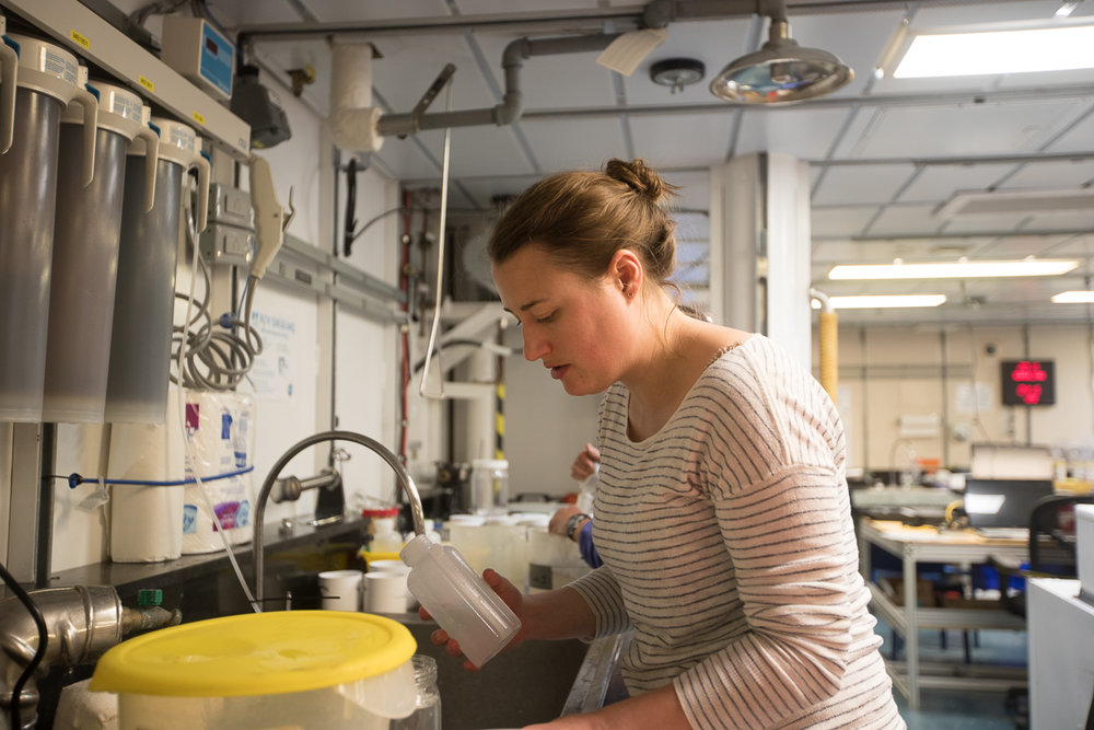 Caitlin Smoot in the late evening working hard to finish processing the zooplankton sample at the first sampling station. Photo credit: Brendan Smith