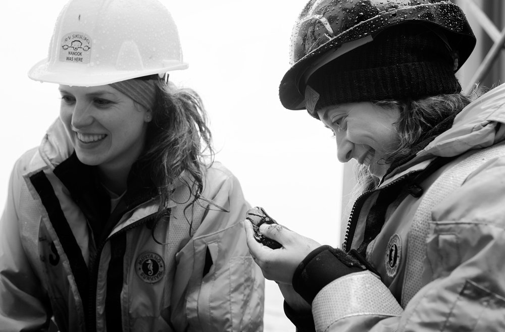 Sarah Seabrook (right) examining a gelatinous benthic creature pulled up from the multi-core. Photo credit: Brendan Smith