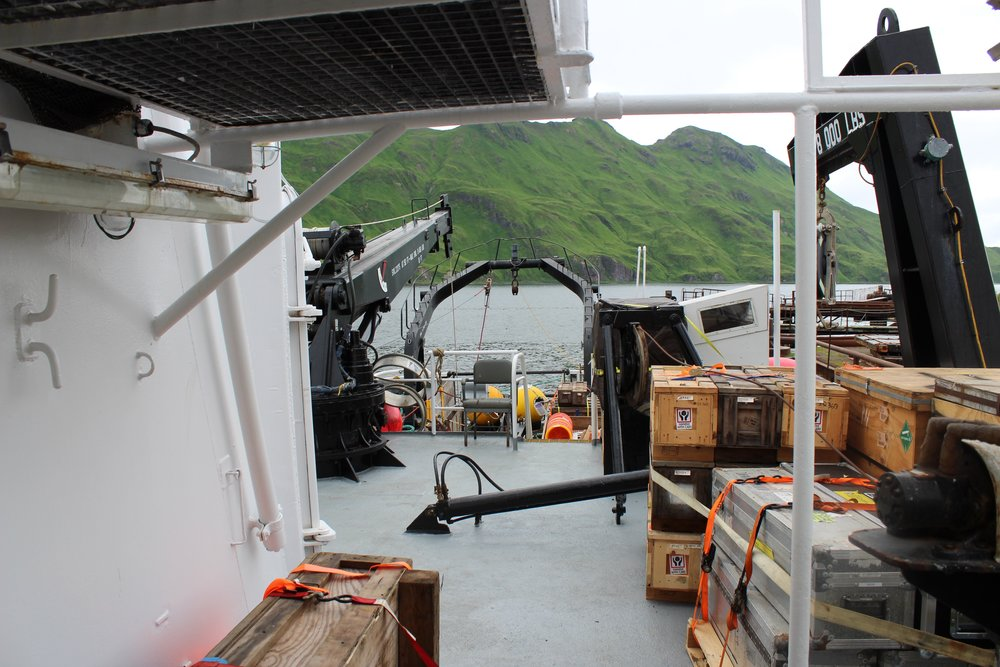 Crates of sampling equipment await unpacking on board the R/V  Ocean Starr . Photo credit: Harmony Wayner