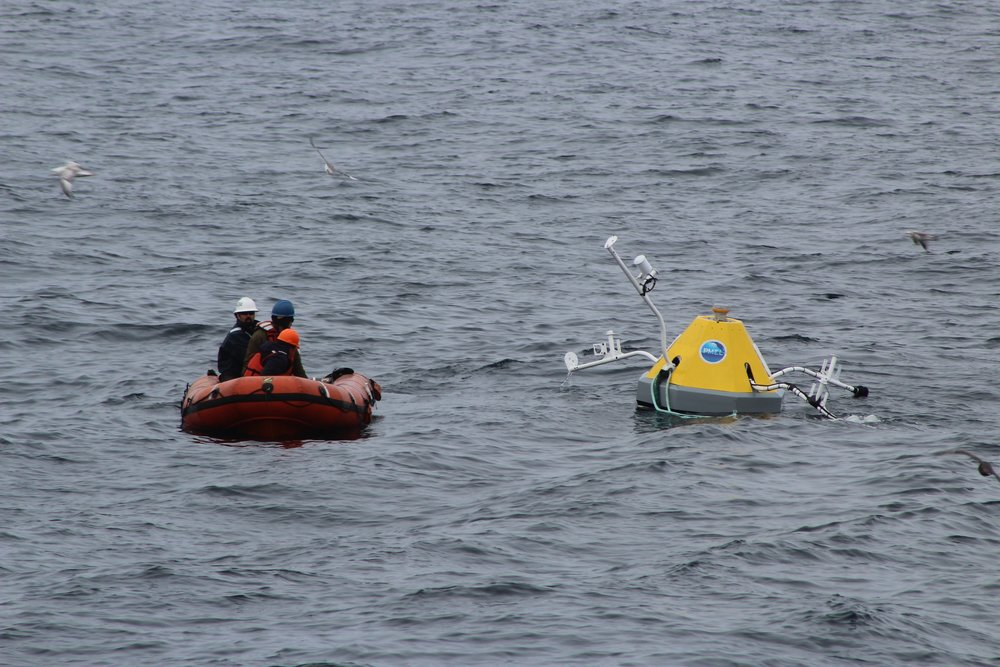 Geoff Lebon, Cameron Backus, and Armando Urrutia deploy the zodiac to repair a mooring which communicates weather conditions via satellite in the Chukchi Sea. Photo credit: Harmony Wayner
