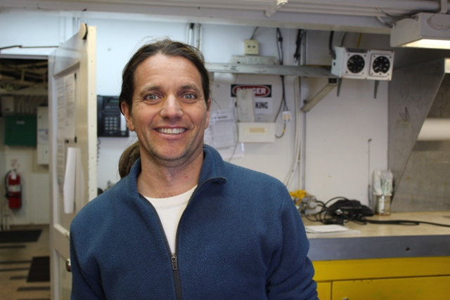 Alex De Robertis explains his work on fish acoustics aboard the R/V  Ocean Starr . Photo credit: Ed Farley