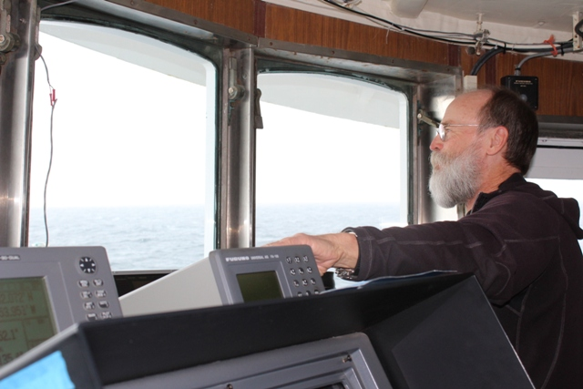 Marty Reedy observes seabirds from the bridge of the R/V Ocean Starr. Photo credit: Ed Farley