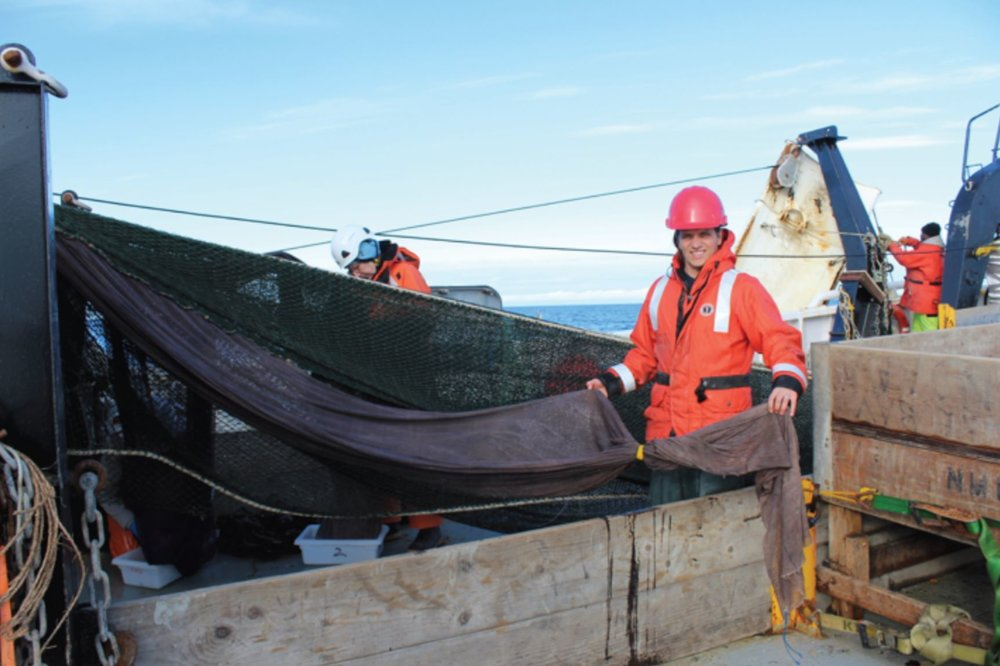 Alex DeRobertis shows us a pocket net on the midwater trawl net. Photo credit: Alicia Flores