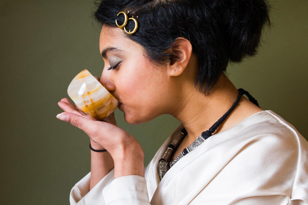 Tanvi sips on some now cold tea. We all know dry mouth is a bitch.