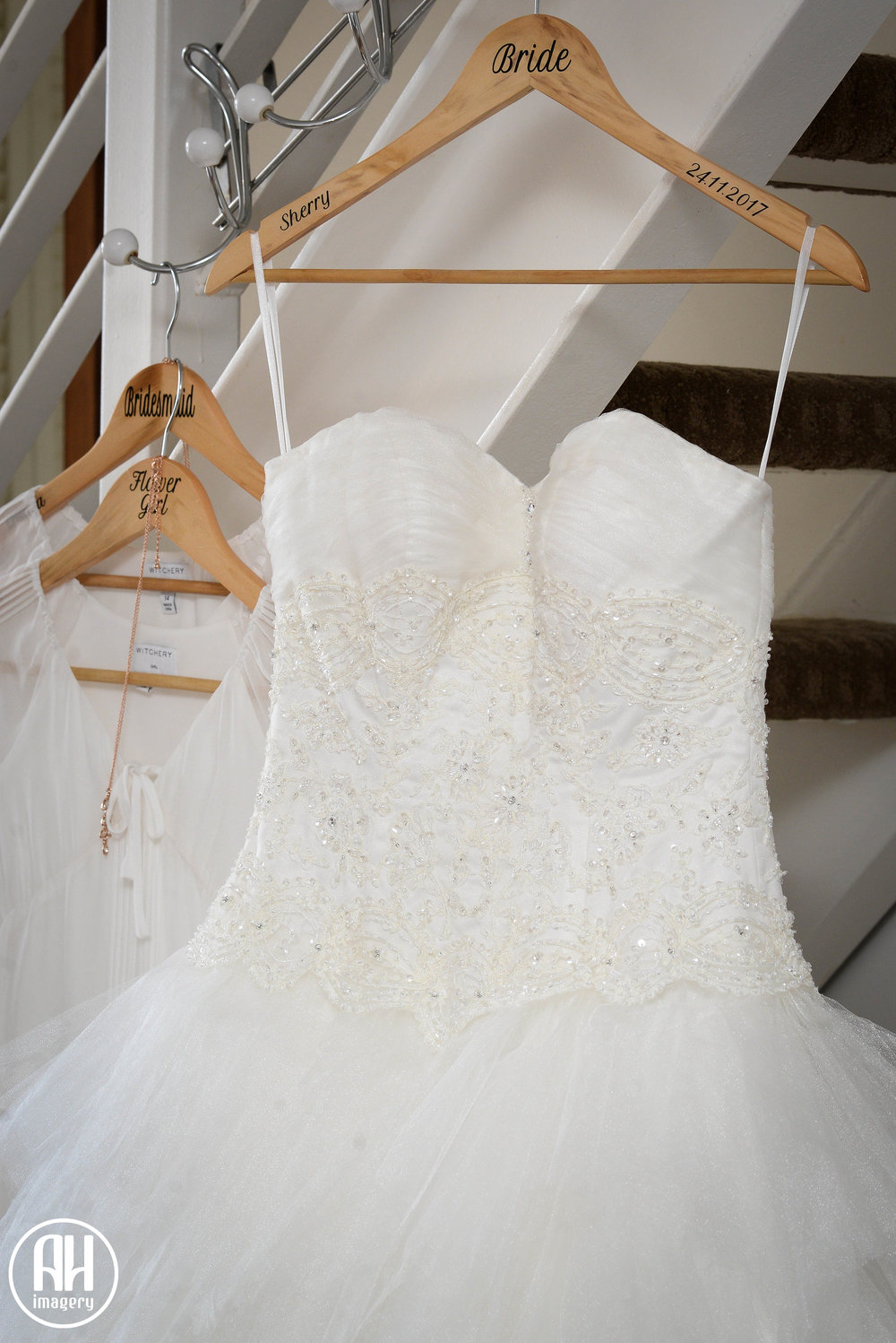 Strapless Disney Wedding dress with crystals hanging up before a wedding