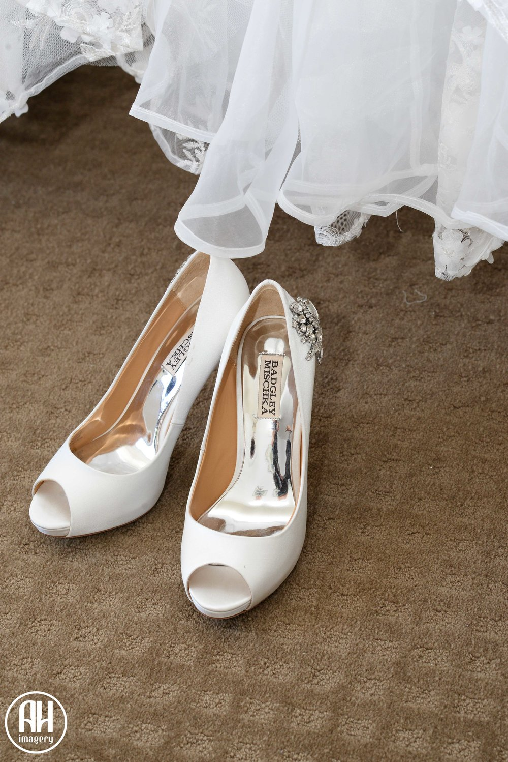 Wedding shoes and wedding dress at Watsons Bay Hotel before the wedding