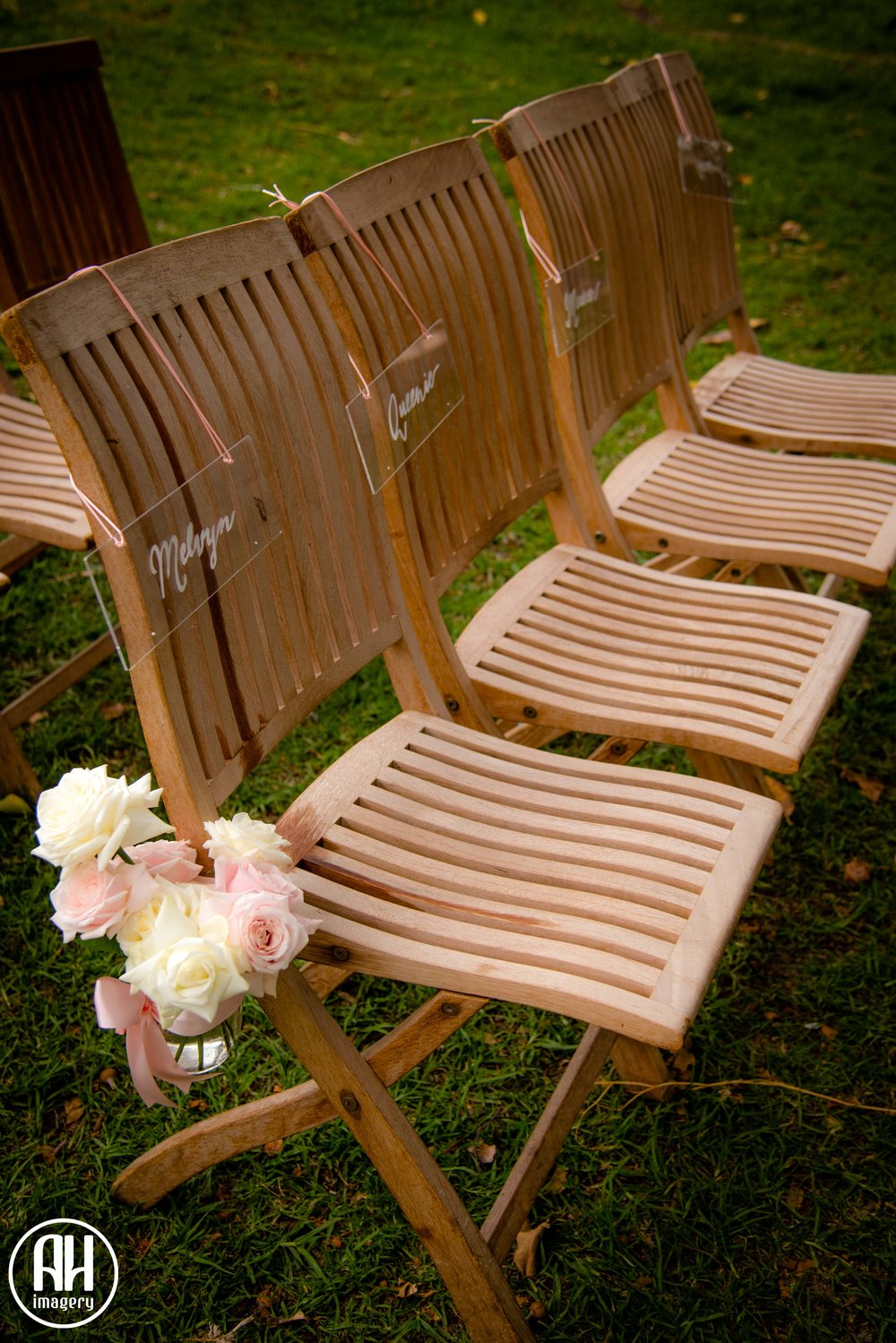 Wedding chairs with decorations and reserved signs at Watsons bay Wedding