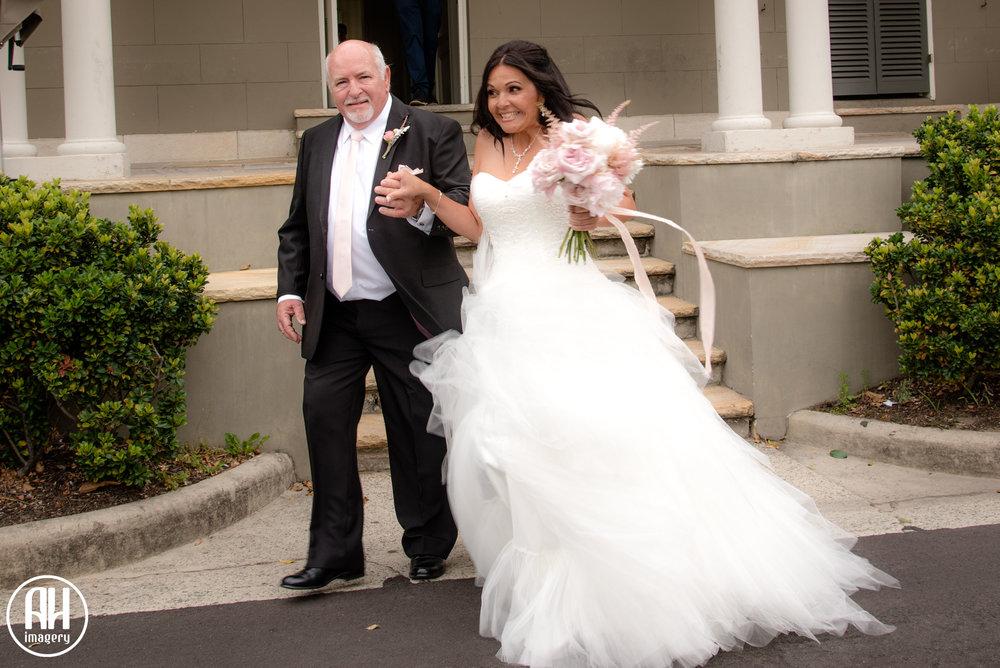 Bride walking down the aisle at Watsons Bay wedding