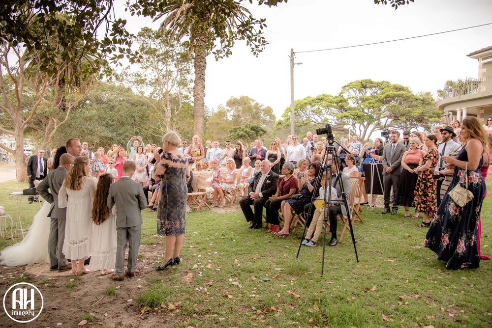 Guests at Watsons Bay wedding sat under the Fig Tree