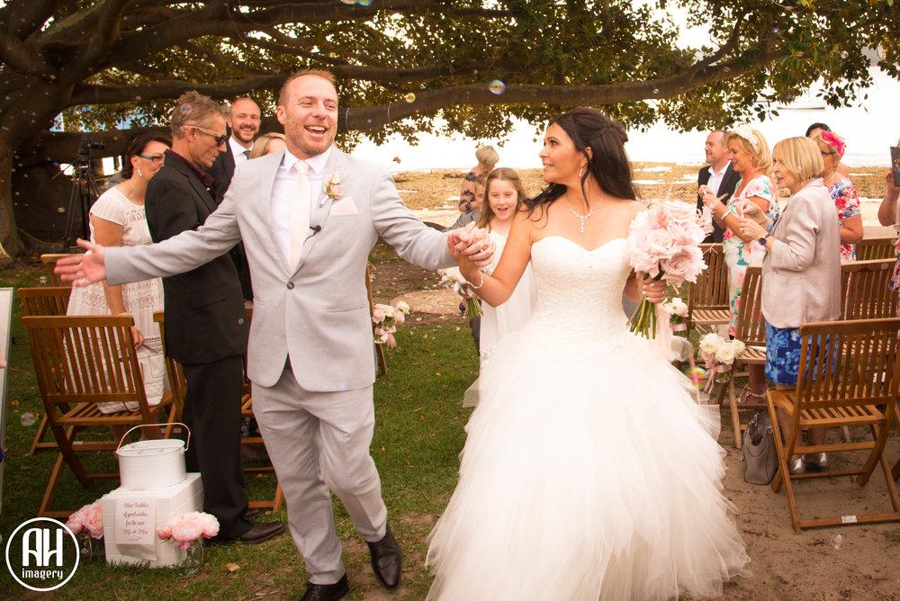 Bride and Groom at Watsons Bay wedding walking down the aisle