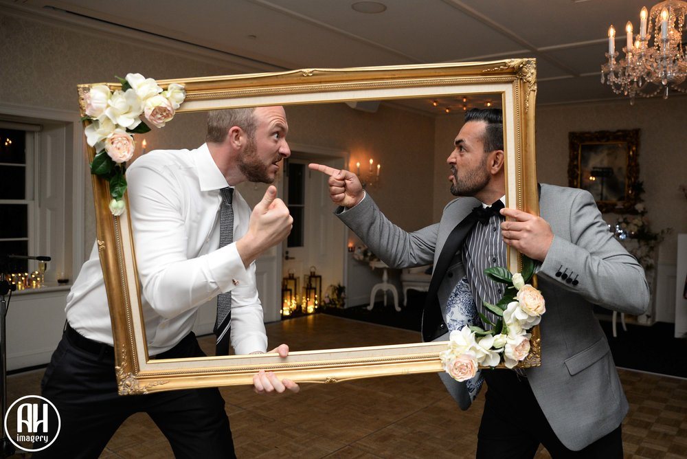Groomsmen at the photobooth at Dunbar House Wedding