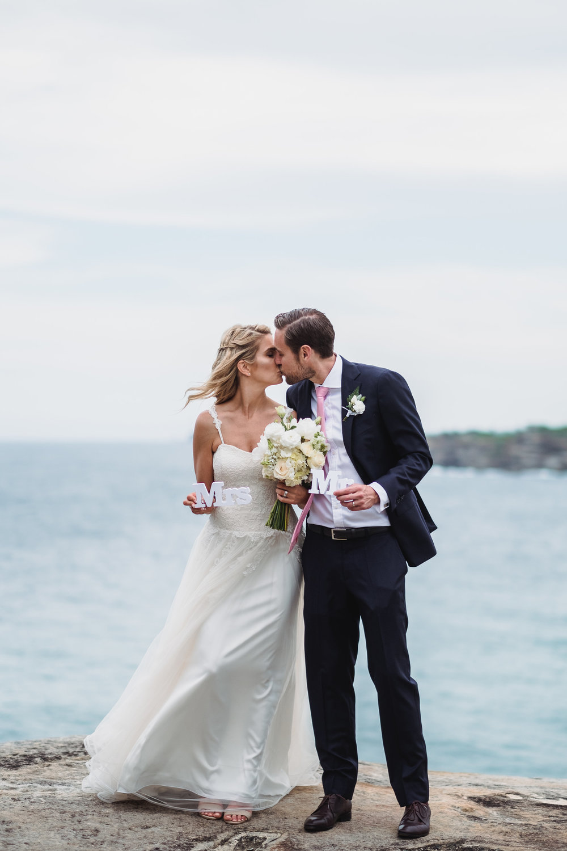 Bride and Groom kissing at their Bondi Beach Wedding