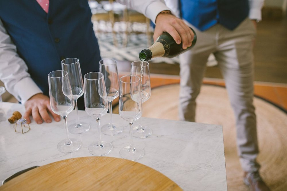 Grooms drinking champagne