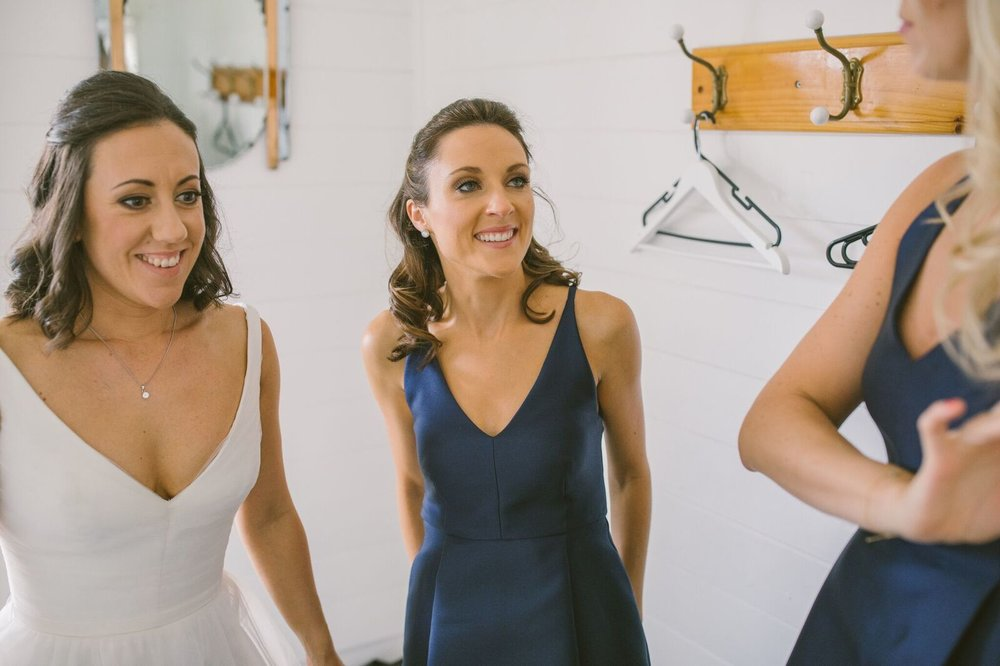 Bride and bridesmaids in navy dresses