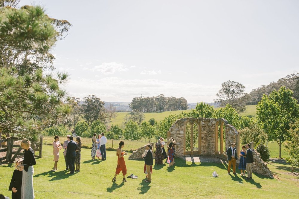 Guests enjoying the outdoors at a wedding