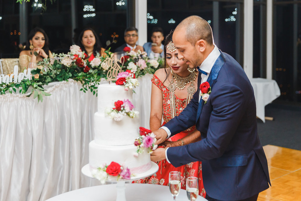 Bride and Groom cutting cake at Nepalese Wedding Panorama House Bulli