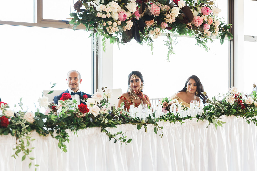 Bride and Groom at Nepalese Wedding Panorama House Bulli. Bridal Table, hanging flowers, bridal table hedge, wedding sign