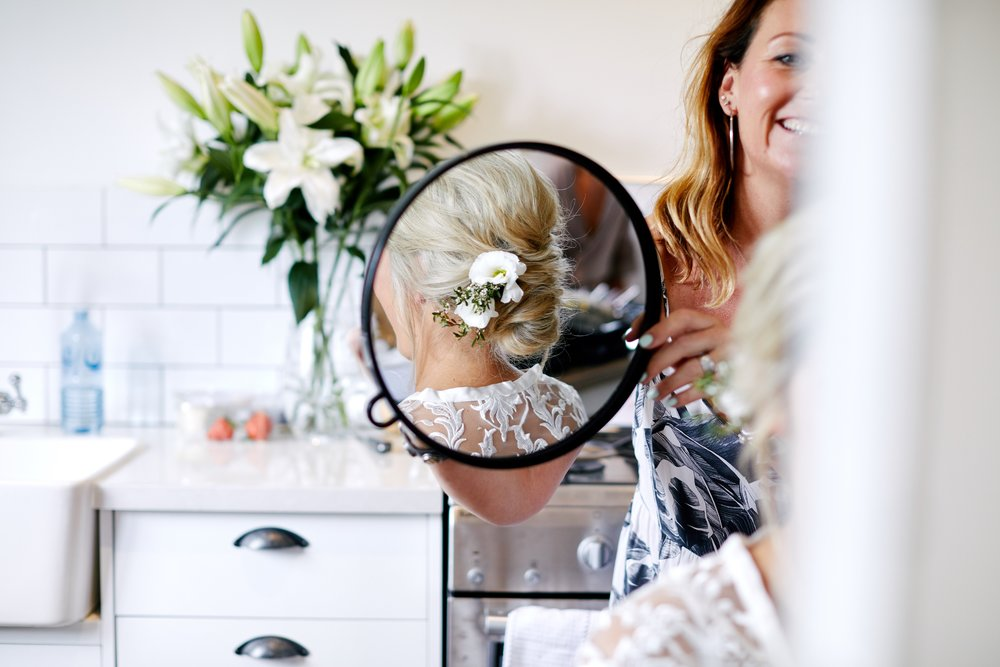 Bride having her hair and make up done before her wedding at The Stables of Somersby in Central Coast NSW