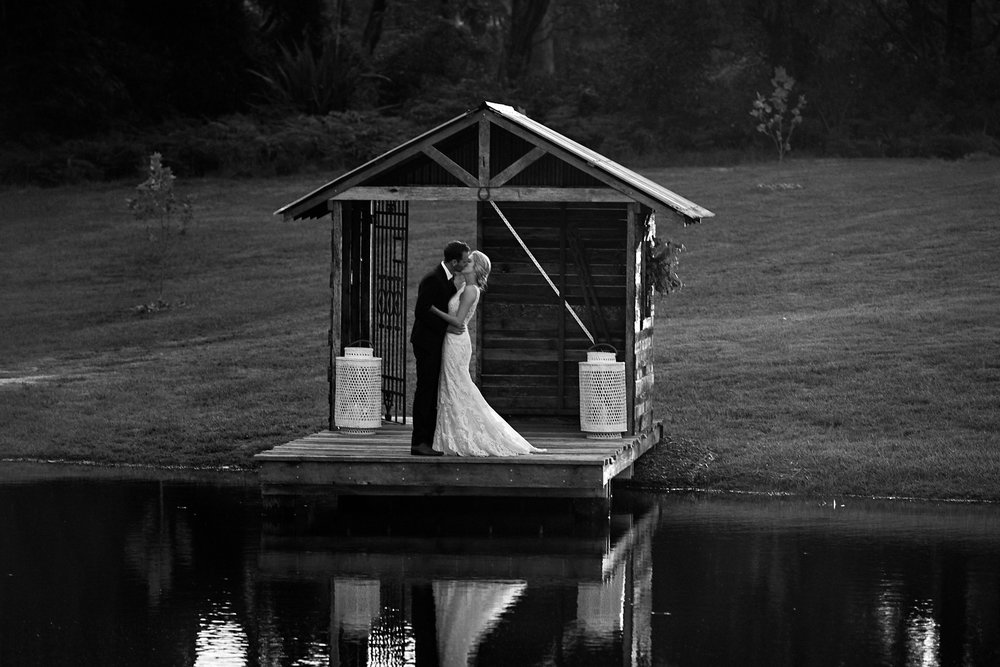 Bride and Groom by a lake at The Stables of Somersby Wedding Venue in NSW Central Coast.
