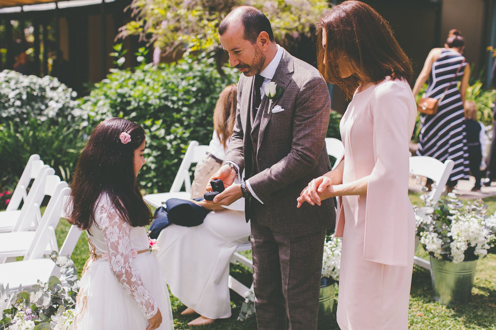 Wedding celebrant, groom and child with wedding rings at Lion Gate Lodge Sydney