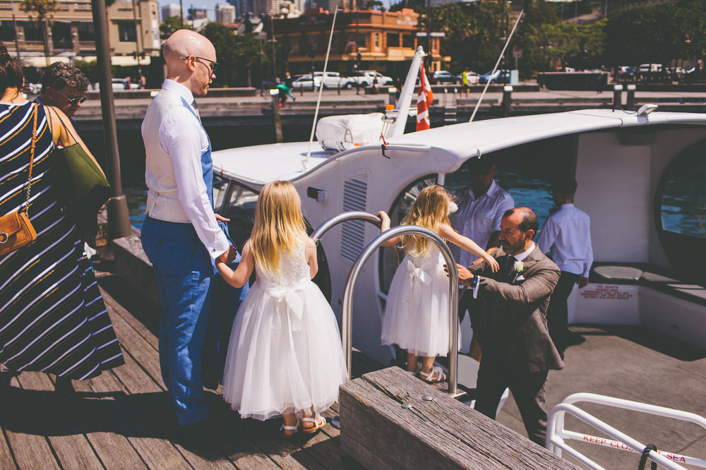 Grooms and flower girls getting on boat. Wedding Planner Sydney.