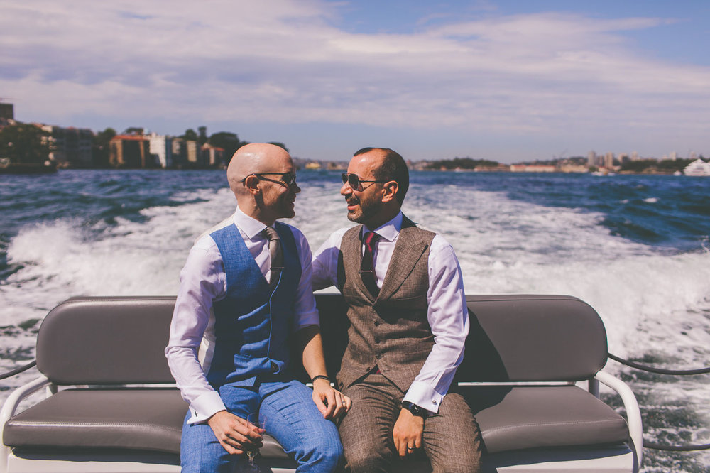 Grooms on the back of the water taxi on their Sydney Harbour wedding. Wedding Planner Sydney.