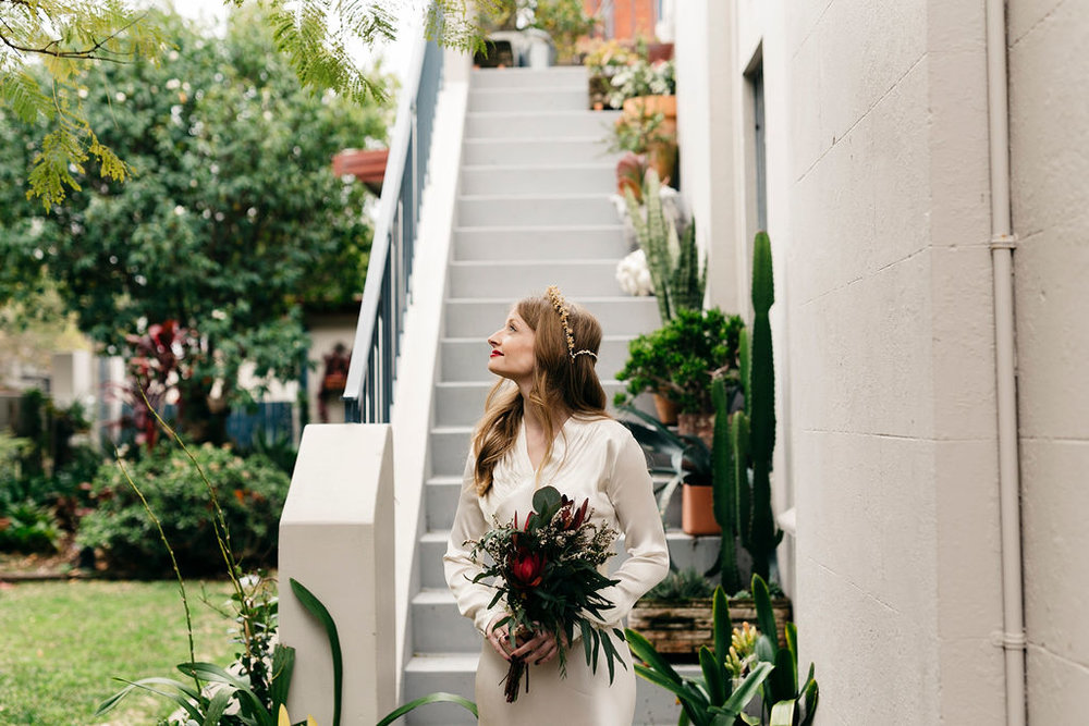 Bride in boho vintage dress with native flowers