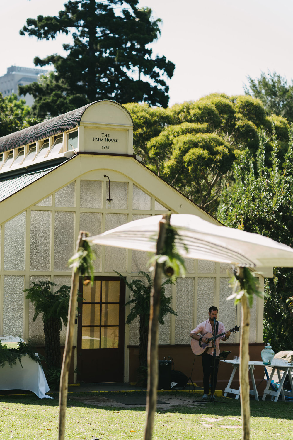 Wedding ceremony set up at The Palm House Lawn, Wedding Chuppah and music playing