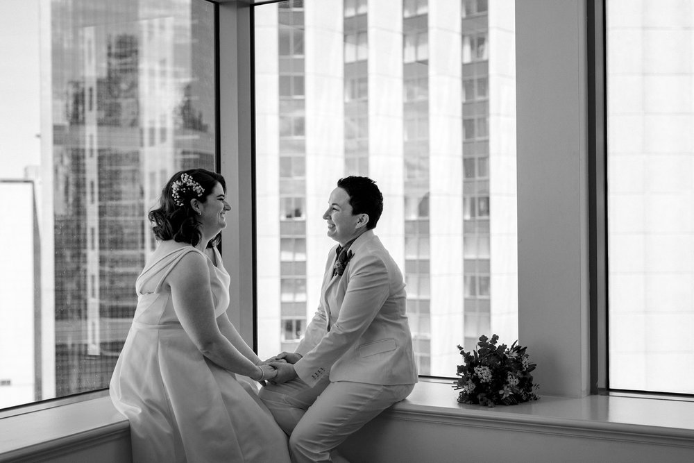Two brides getting ready for their wedding day at Sydney Royal Botanic Garden