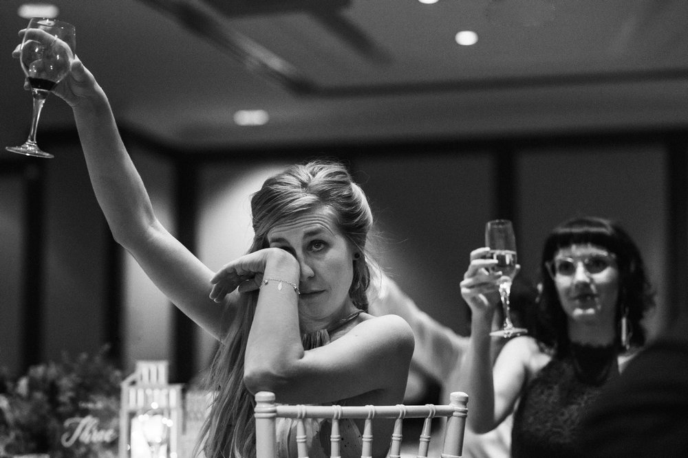 Wedding guests raising their glasses for a wedding toast at Shangri-La Sydney