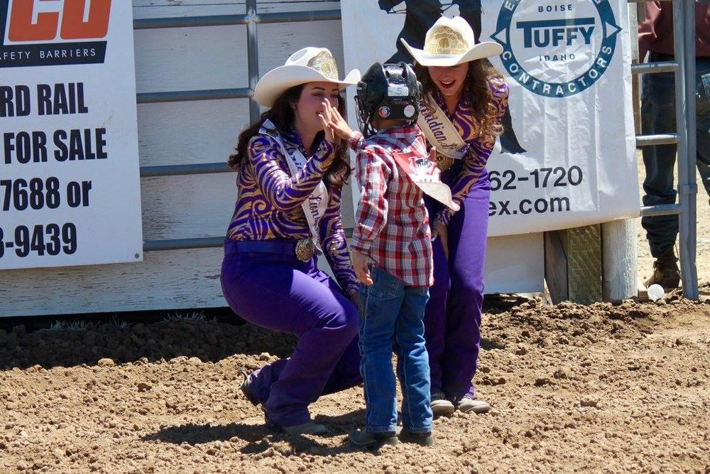 Meridian Lions Rodeo  Queens high-five a mutton buster. Photo courtesy of Curtis Yanskey.