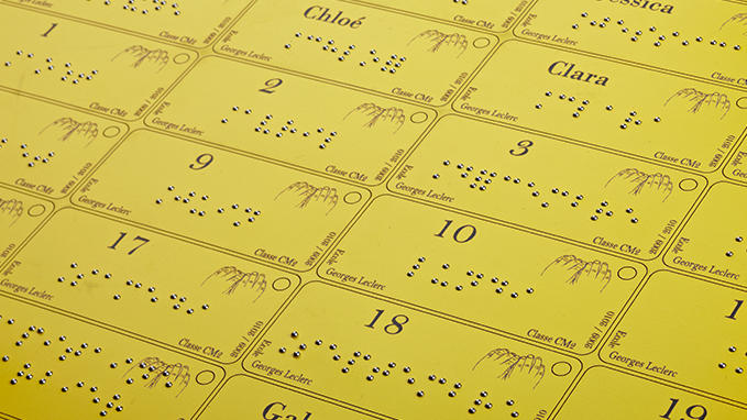 Engraving of badges and labels in Braille